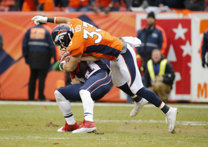 Peyton Manning and Broncos defence outgun Tom Brady and Patriots