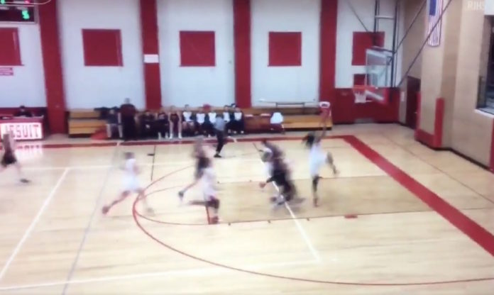 Fifteen-year-old girl dunks in basketball match