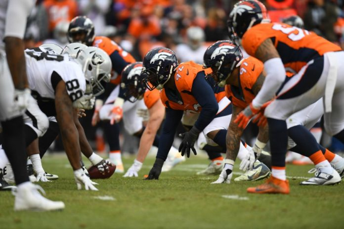 Raiders fall to Broncos, may have lost Carr in the process