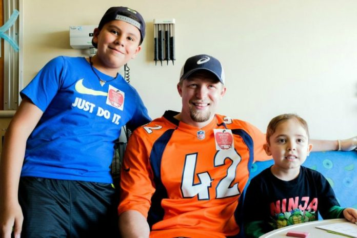 newest collection e1176 a62ae Casey Kreiter makes a visit to the Children's Hospital Colorado