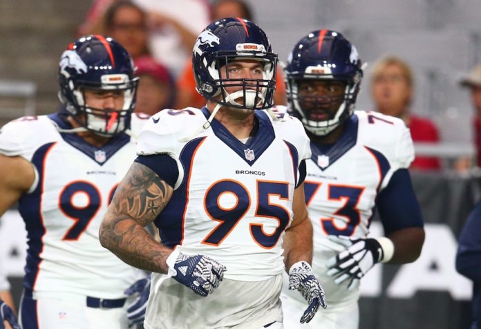 Broncos DE Wolfe suffers ankle injury