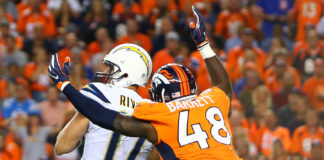 Denver Broncos linebacker Shaquil Barrett (48) sacks Los Angeles Chargers quarterback Philip Rivers (17) in the second half at Sports Authority Field at Mile High.