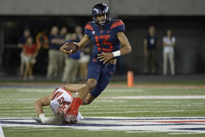 Tate rushes for 327 yards, Arizona beats Colorado 45-42