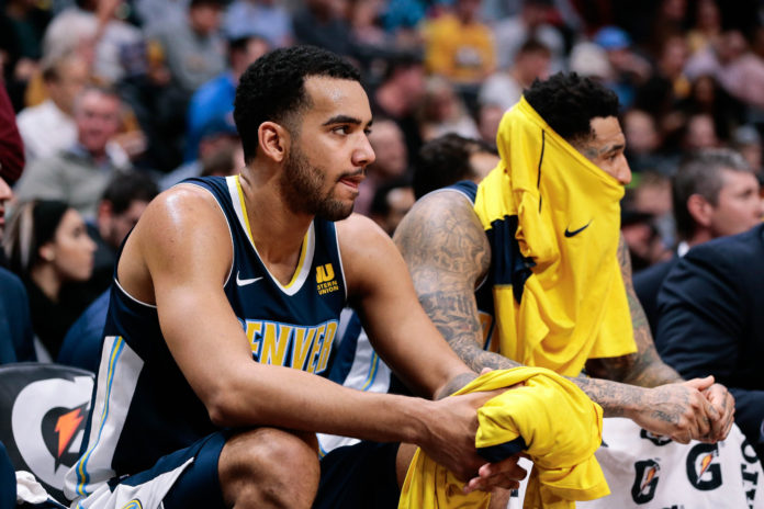 Denver Nuggets forward Trey Lyles (7) on the bench in the second quarter against the Utah Jazz at the Pepsi Center.