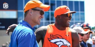 Peyton Manning (left) and DeMarcus Ware (right) share a laugh on the field Thursday.