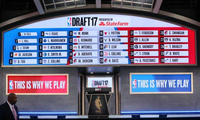 A general view of a video board displaying all thirty first round selections in the 2017 NBA Draft at Barclays Center