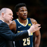 Denver Nuggets head coach Michael Malone talks with guard Malik Beasley (25) in the second quarter against the Memphis Grizzlies at the Pepsi Center.