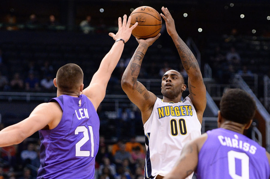 Denver Nuggets forward Darrell Arthur (00) shoots the ball over Phoenix Suns center Alex Len (21) in the first half at Talking Stick Resort Arena.