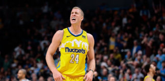 Denver Nuggets center Mason Plumlee (24) reacts after a play in the fourth quarter against the San Antonio Spurs at the Pepsi Center.