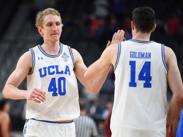 UCLA Bruins center Thomas Welsh (40) celebrates with UCLA Bruins forward Gyorgy Goloman (14) after the Bruins defeated the Stanford Cardinal in a quarterfinal match of the Pac-12 Tournament at T-Mobile Arena.