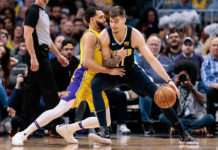 Denver Nuggets forward Juancho Hernangomez (41) dribbles against Los Angeles Lakers guard Tyler Ennis (left) in the third quarter at the Pepsi Center.