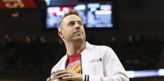 Case Keenum looks to throw a football into the crowd during the game between the Houston Rockets and the San Antonio Spurs at Toyota Center