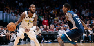 Minnesota Timberwolves guard Jamal Crawford (11) guards Denver Nuggets guard Will Barton (5) in the second quarter at the Pepsi Center.