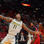 Denver Nuggets forward Wilson Chandler (21) reaches for the ball while being guarded by Miami Heat forward Josh Richardson (0) during the first half at American Airlines Arena.