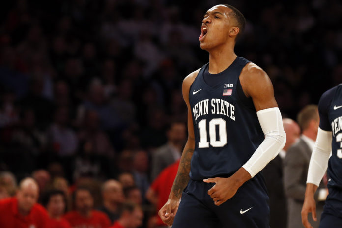Penn State Nittany Lions guard Tony Carr (10) reacts after making a basket against the Utah Utes during the first half of the NIT championship game at Madison Square Garden. Mandatory Credit: Adam Hunger