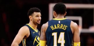 Denver Nuggets guard Jamal Murray (27) and guard Gary Harris (14) talk in the fourth quarter against the Los Angeles Clippers at the Pepsi Center.