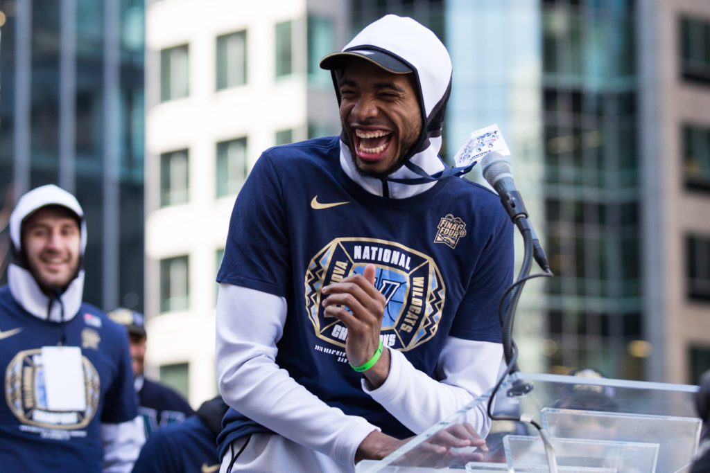 Villanova Wildcats guard Mikal Bridges laughs as he addresses fans from the podium at Dilworth Park.