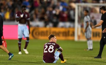Colorado Rapids midfielder Sam Nicholson (28) sits on the pitch following the draw to the Chicago Fire at Dick's Sporting Goods Park