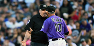 Colorado Rockies manager Bud Black (10) argues with first base umpire Bill Welke (3) in the fourth inning against the New York Mets at Coors Field. Mandatory Credit: Ron Chenoy-USA TODAY Sports