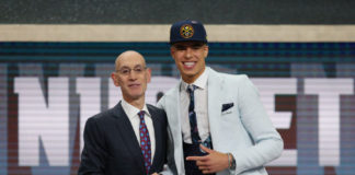 Michael Porter, Jr. (Missouri) greets NBA commissioner Adam Silver after being selected as the number fourteen overall pick to the Denver Nuggets in the first round of the 2018 NBA Draft at the Barclays Center.