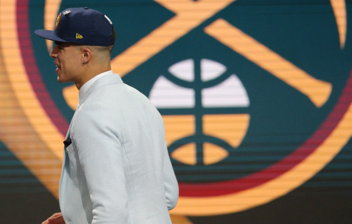 Michael Porter, Jr. (Missouri) walks to the stage after being selected as the number fourteen overall pick to the Denver Nuggets in the first round of the 2018 NBA Draft at the Barclays Center.