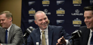 Denver Nuggets head coach Michael Malone (center), general manager GM Tim Connelly (left) and president Josh Kroenke (right) react to a media question during a press conference at the Pepsi Center