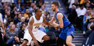 Dallas Mavericks forward Chandler Parsons (25) defends against Denver Nuggets forward Darrell Arthur (00) in the fourth quarter at the Pepsi Center.