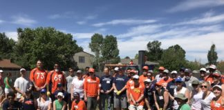 A group of nearly 50 Broncos employees and team members work with Kaboom! to build a playground for a local Boys and Girl's Club. Credit: Patrick Smyth (Twitter)