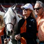 Broncos mascot Thunder with owners Magness and Ernie Blake. Credit: Isaiah J. Downing, USA TODAY Sports.