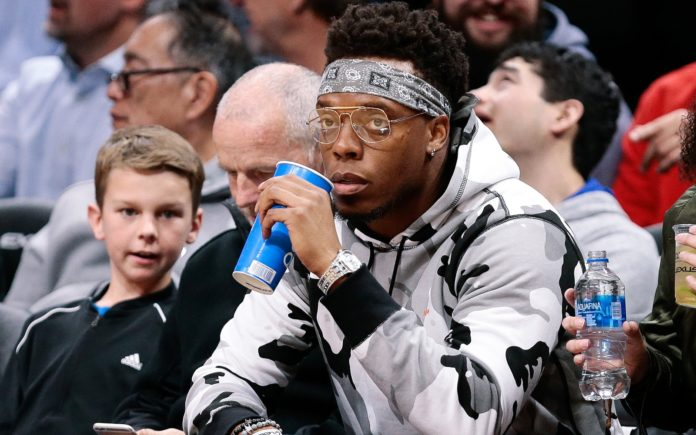 Brandon Marshall, courtside at a Nuggets game. Credit: Ron Chenoy, USA TODAY Sports.