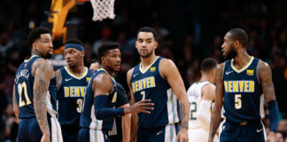 Denver Nuggets forward Wilson Chandler (21) and guard Torrey Craig (3) and guard Malik Beasley (25) and guard Will Barton (5) celebrate with forward Trey Lyles (7) after a play in the second quarter against the Utah Jazz at the Pepsi Center.