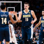 Denver Nuggets guard Gary Harris (14) and center Nikola Jokic (15) and guard Jamal Murray (27) in the third quarter against the New Orleans Pelicans at the Pepsi Center