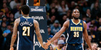 Denver Nuggets forward Wilson Chandler (21) and forward Kenneth Faried (35) in the third quarter against the Memphis Grizzlies at the Pepsi Center.