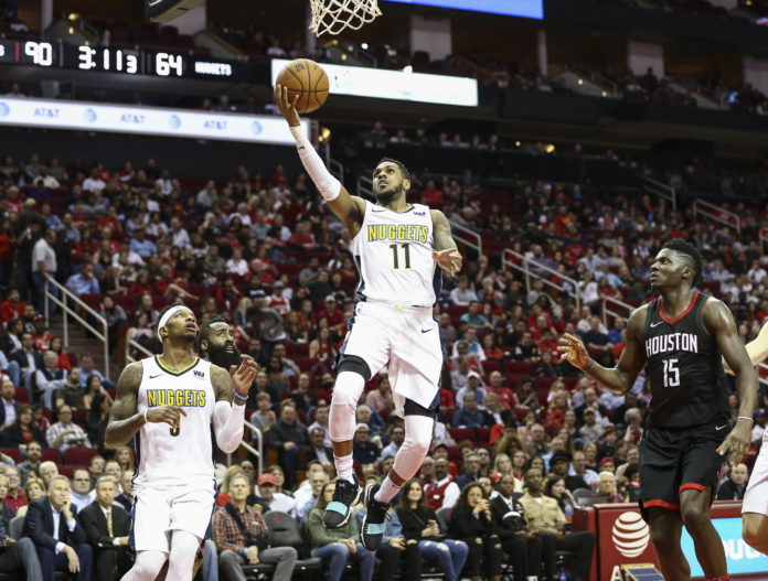 Denver Nuggets guard Monte Morris (11) shoots the ball during the third quarter against the Houston Rockets at Toyota Center.