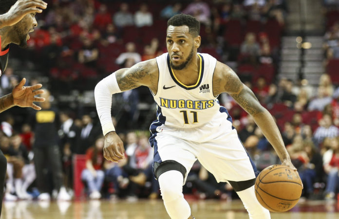 Denver Nuggets guard Monte Morris (11) dribbles the ball during the game against the Houston Rockets at Toyota Center