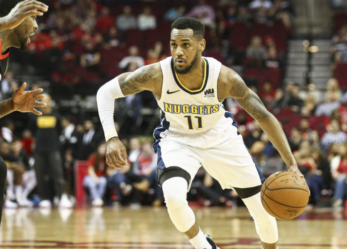 Denver Nuggets guard Monte Morris (11) dribbles the ball during the game against the Houston Rockets at Toyota Center.