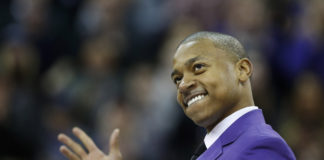 Former Washington Huskies guard Isaiah Thomas walks onto the court during a ceremony to retire his jersey number during the Huskies' half time against the Colorado Buffaloes at Alaska Airlines Arena.