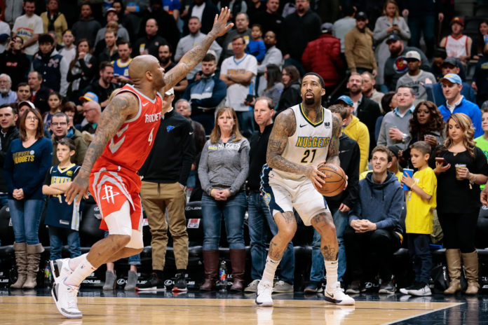 Houston Rockets forward P.J. Tucker (4) guards Denver Nuggets forward Wilson Chandler (21) in the first quarter at the Pepsi Center.