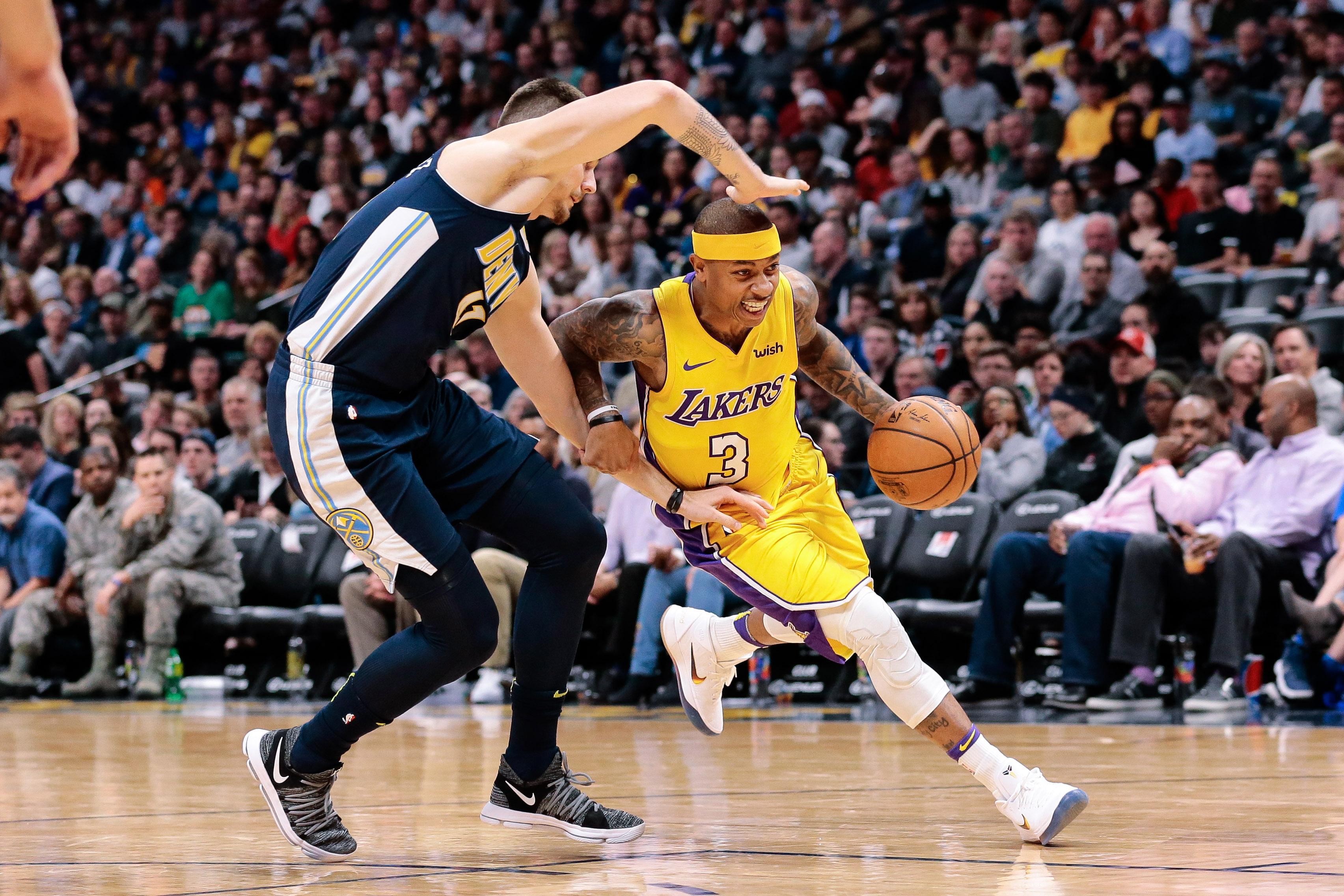 Denver Nuggets forward Juancho Hernangomez (41) guards Los Angeles Lakers guard Isaiah Thomas (3) in the third quarter at the Pepsi Center.