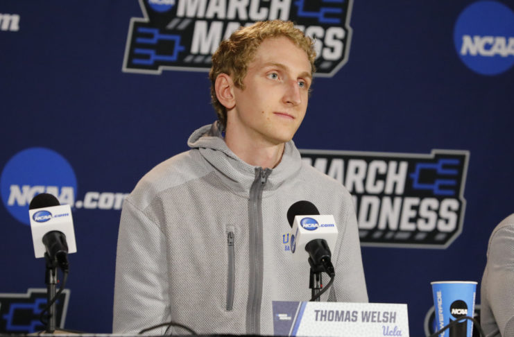 UCLA Bruins center Thomas Welsh (40) talks to media during practice before the First Four of the NCAA Tournament at Dayton Arena.