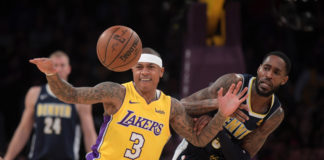Los Angeles Lakers guard Isaiah Thomas (3) and Denver Nuggets forward Will Barton (5) battle for the ball in the first half during an NBA basketball game at Staples Center. The Lakers defeated the Nuggets 112-103.