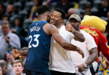 Minnesota Timberwolves guard Jimmy Butler (23) greets Denver Broncos player Demaryius Thomas before the game against the Denver Nuggets at the Pepsi Center.