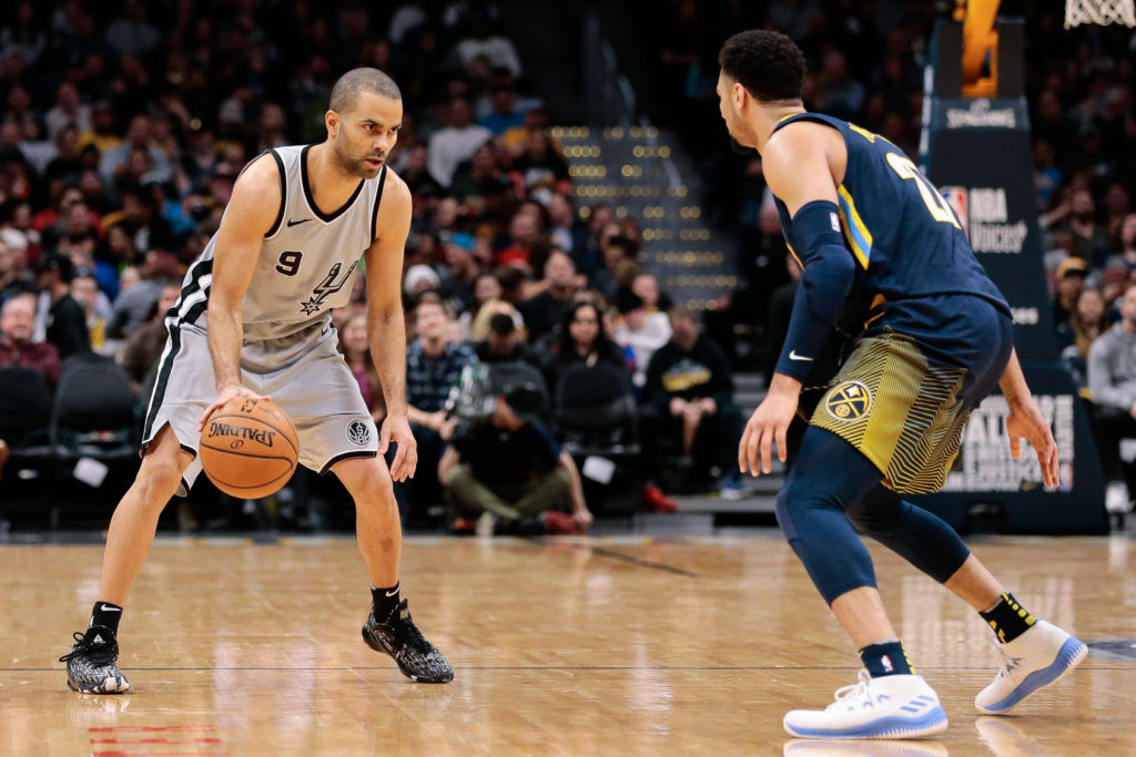 Denver Nuggets guard Jamal Murray (27) guards San Antonio Spurs guard Tony Parker (9) in the second quarter at the Pepsi Center.