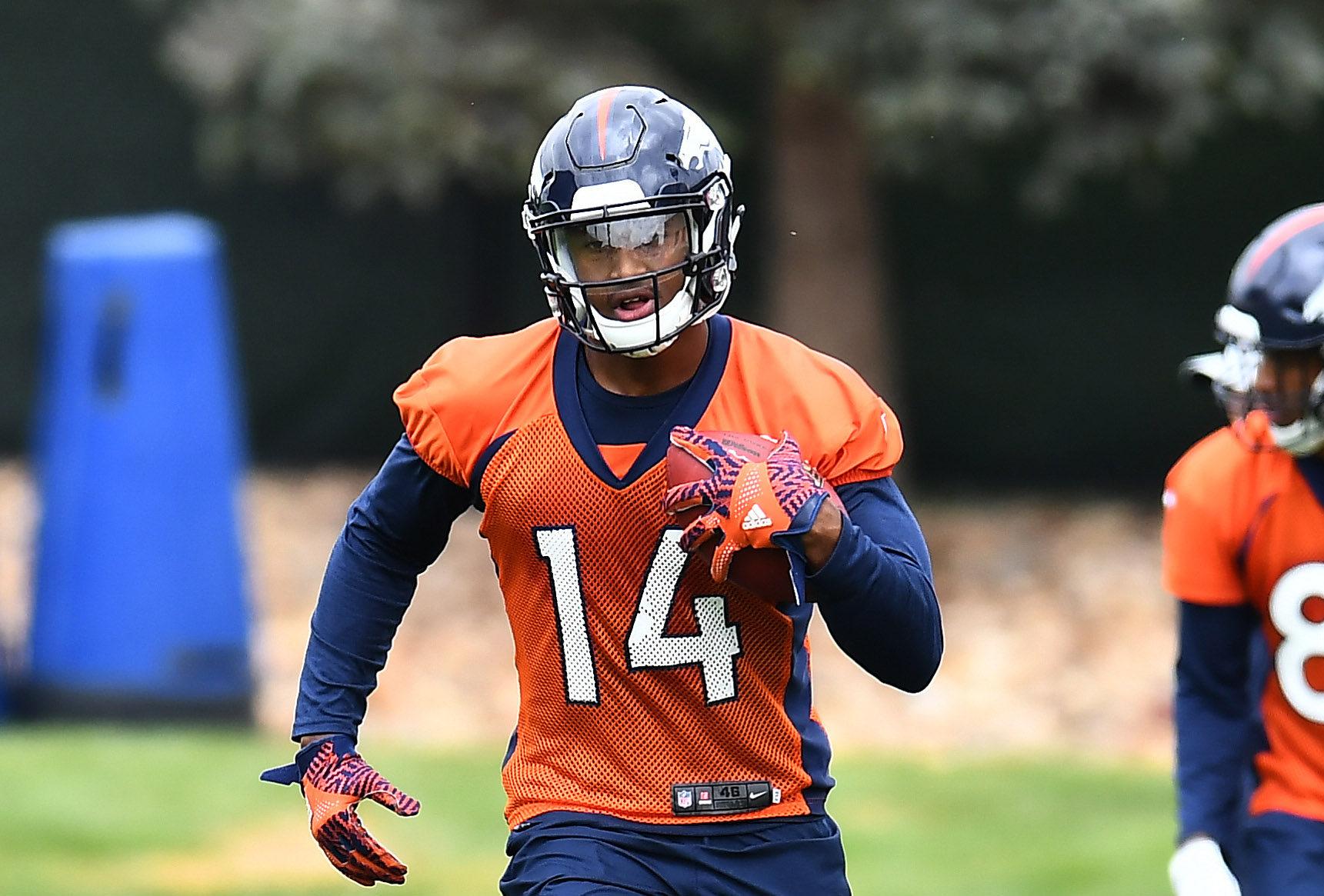 Denver Broncos wide receiver Courtland Sutton (14) participates in drills during rookie minicamp at the UCHealth Training Center.
