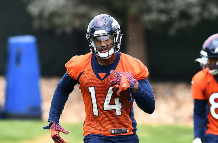 Denver Broncos wide receiver Courtland Sutton (14) participates in drills during rookie minicamp at the UCHealth Training Center.