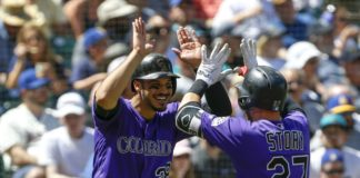 Nolan Arenado and Trevor Story celebrate Story's home run during Sunday's game. Credit: Jennifer Buchanan, USA TODAY Sports.