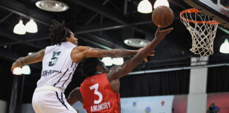 oronto Raptors forward OG Anunoby (3) shoots inside the defense of Denver Nuggets guard DeVaughn Akoon-Purcell (5) during the first half at Cox Pavilion.