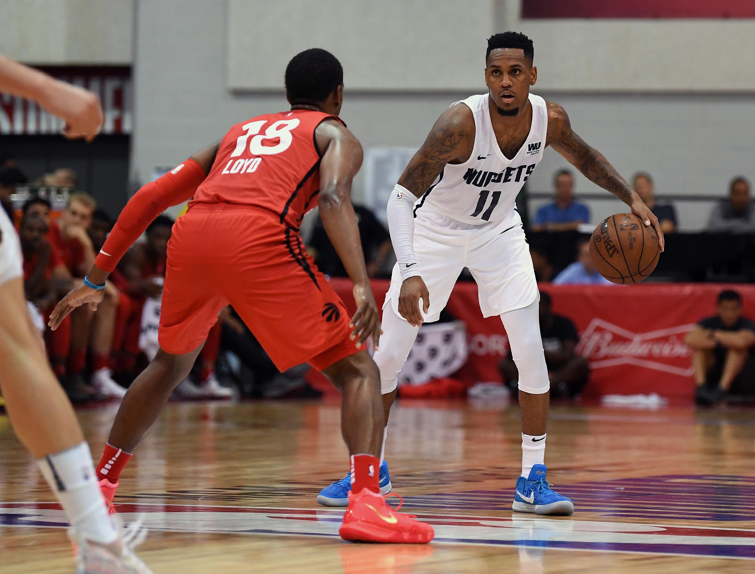Denver Nuggets guard Monte Morris (11) dribbles against Toronto Raptors guard Jordan Loyd (18) during the second half at Cox Pavilion.