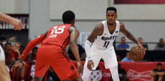 Denver Nuggets guard Monte Morris (11) dribbles against Toronto Raptors guard Jordan Loyd (18) during the second half at Cox Pavilion.