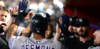 Ian Desmond celebrates a score. Credit: Joe Camporeale, USA TODAY Sports.